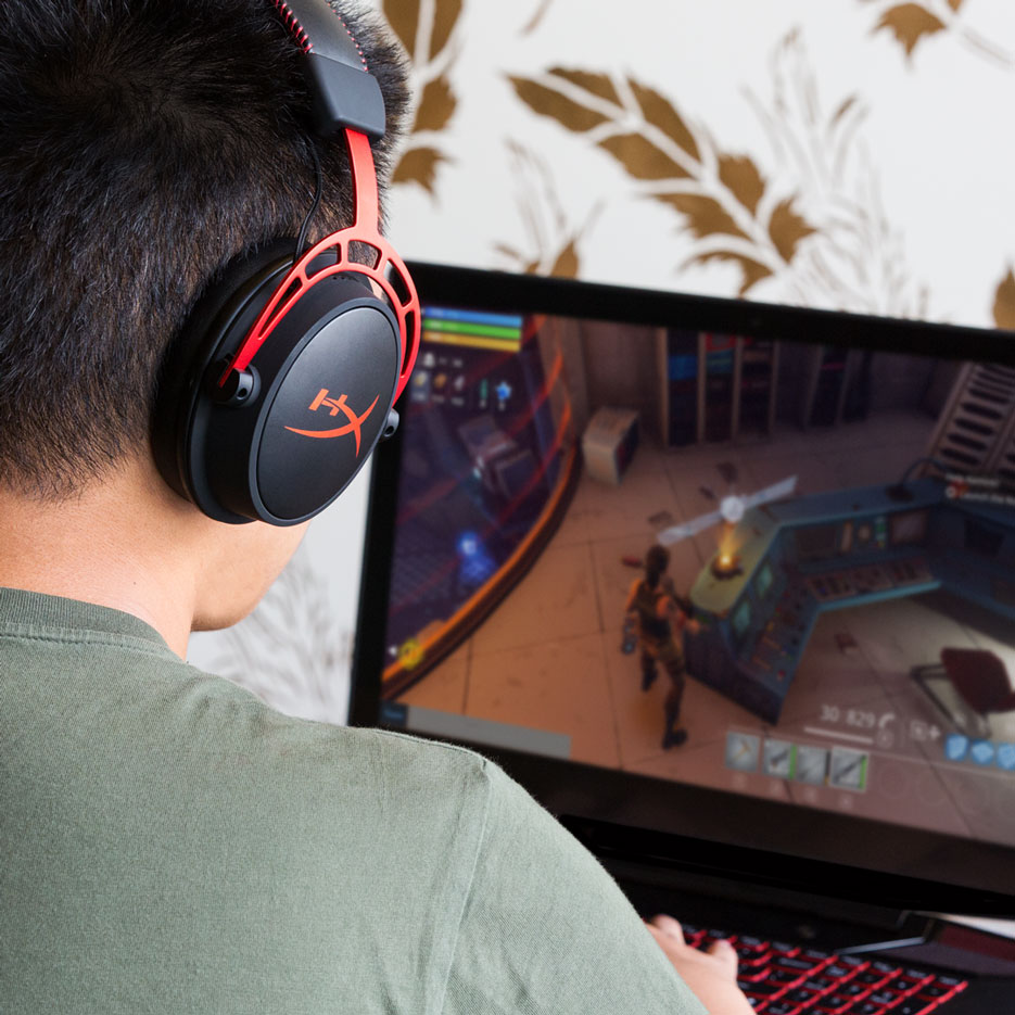 Model Playing Fortnite While Wearing Cloud Alpha