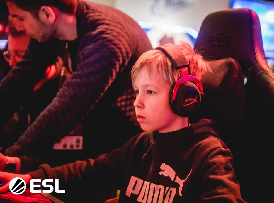 Boy playing at the Katowice Royale Festival using HyperX Cloud Alpha Gaming Headset