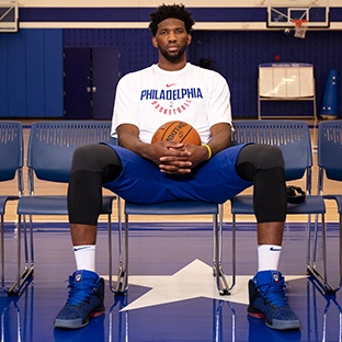 Photo of HyperX Influencer Joel Embiid with basketball wearing a Philadelphia shirt