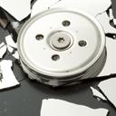 A broken hard drive platter