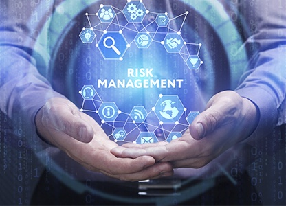 Young businessman shows the word: Risk management