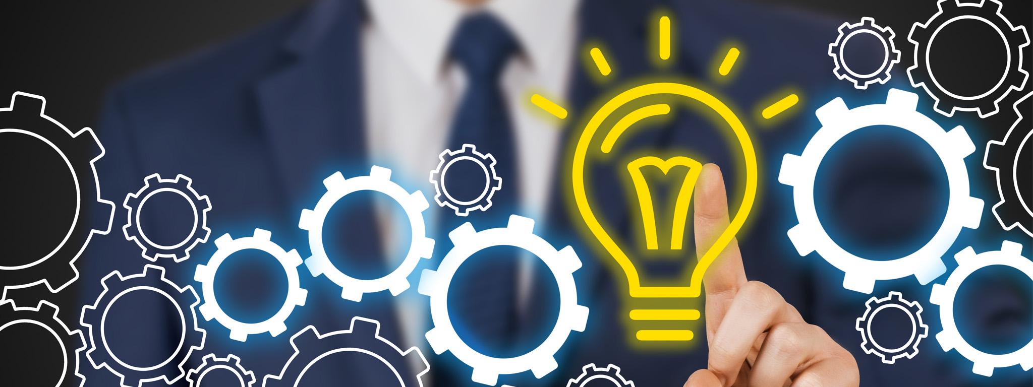 A man in a suit touching a vector image of a light bulb surrounded connected cogwheels (Um homem de terno tocando uma imagem de vetor de uma lâmpada cercada de engrenagens conectadas)