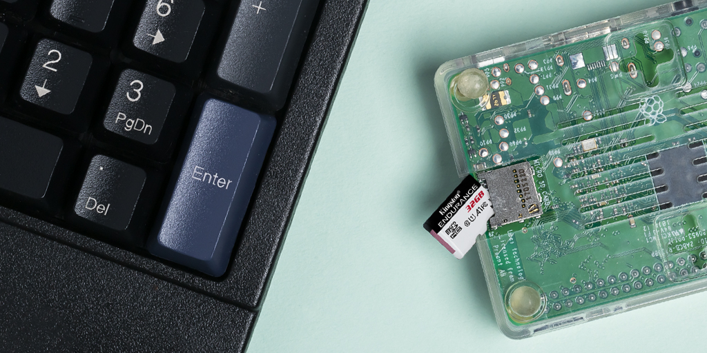 Raspberry Pi small board computer with a Kingston microSD next to a keyboard