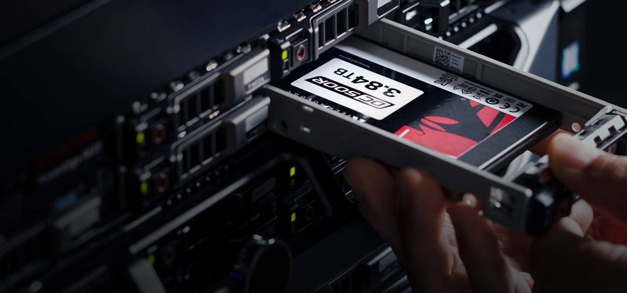 a hand installing Kingston DC500R SSD in a server rack